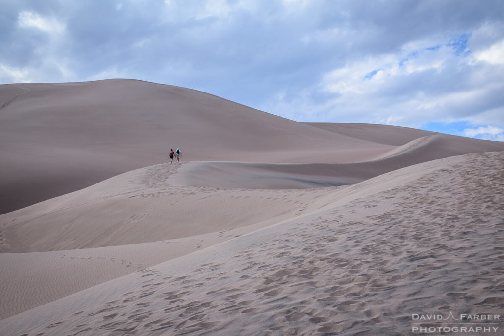 A couple taking the ridge up the dunes | Great Sand Dunes National Park